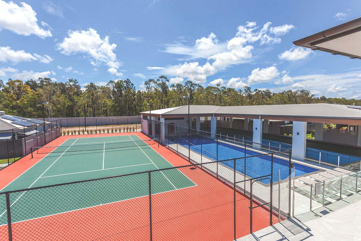 Living Gems Pacific Paradise country club tennis court and pool