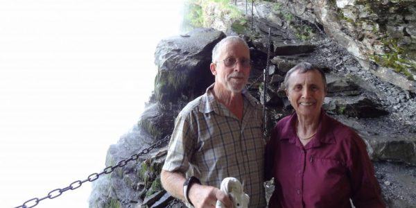 Janet-and-John-under-a-waterfall-in-Norway-e1504664118973-1024x557